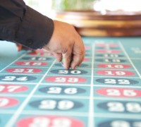 Gambling Table with a Hand