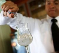 Bartender Pouring a Glass of Liquor