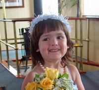 Smiling 5 year old flower girl
